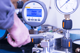 person calibrating and servicing machines