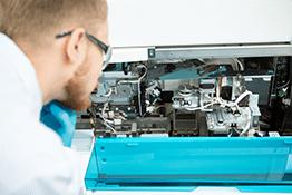 repair technician maintaining equipment